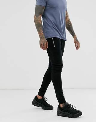 Asos Design DESIGN super skinny joggers in black with silver zip pockets