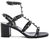 Valentino Leather Rockstud Sandals in Black.