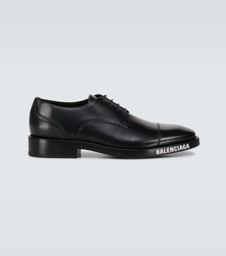 Balenciaga Leather derby shoes with logo