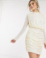In The Style x Fashion Influx sequin ruched high neck mini dress with open back in cream