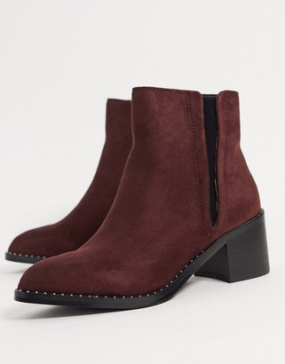 Call it SPRING crareweth heeled ankle boots with studded rand in red