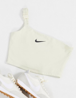 Nike one shoulder buckle crop top in off white