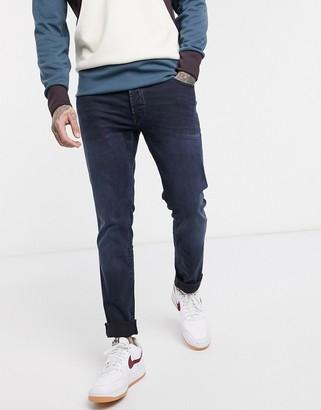 Solid slim fit jean in dark wash blue