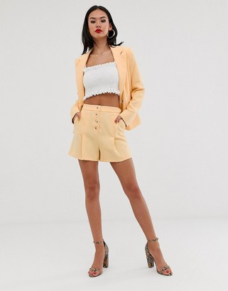 Miss Selfridge tailored shorts with button front in yellow
