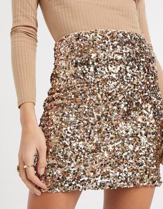 ASOS DESIGN sequin mini skirt in gold