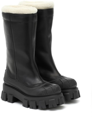 Prada Monolith shearling-lined leather boots