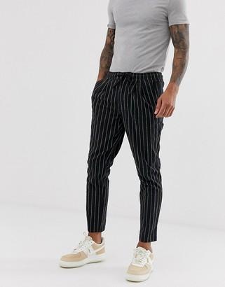ASOS DESIGN cigarette pants with elastic waist in textured stripe