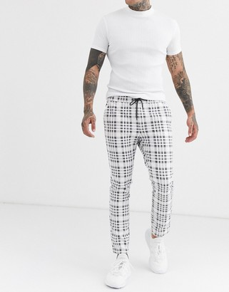Asos Design DESIGN skinny trousers with elastic waist in wide grey check-White