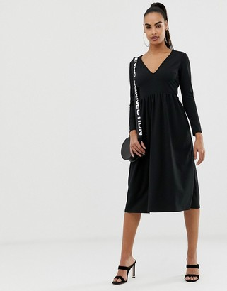 Asos DESIGN midi scuba crepe skater dress with open back