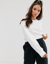 Reebok Vector cropped sweatshirt in white
