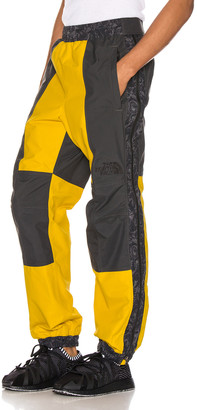 The North Face Black 94 Rage Rain Pant in Leopard Yellow & Asphalt Grey | FWRD