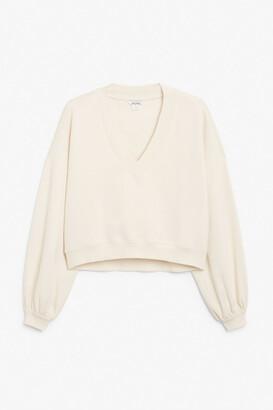Monki Cropped varsity sweater