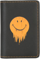 Coach smiley print cardholder - men - Leather - One Size