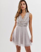 Asos Design DESIGN mini dress with pearl and sequin embellished wrap bodice