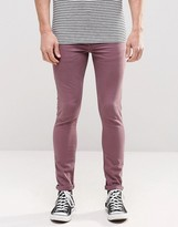 Asos Super Skinny Jeans In Purple