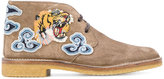 Gucci tiger's head appliqué boots - men - Calf Leather/Leather/rubber - 4.5