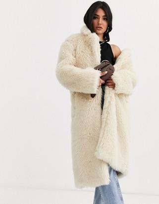 Asos Design DESIGN faux fur teddy longline coat in cream