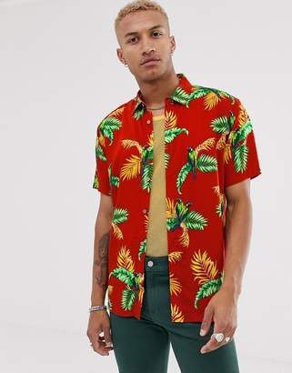 Bershka short sleeve shirt with tropical print in red