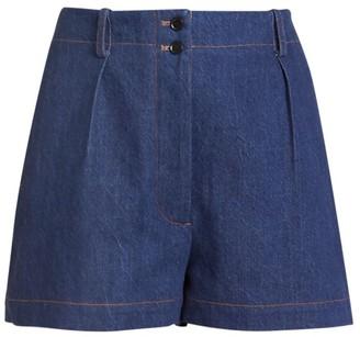 Alaia Mid-Rise One Pocket Denim Shorts