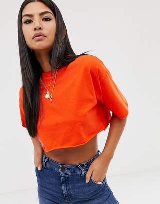 Asos Design DESIGN super crop t-shirt with raw edge in red