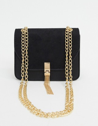 ASOS DESIGN cross body bag with suedette flap and tassel in black