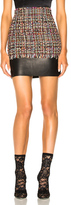 Alexander McQueen Leather Trim Tweed Mini Skirt in Black,Red.