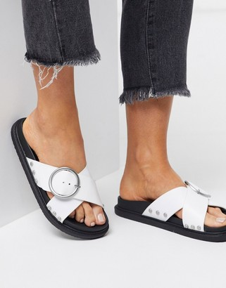 Truffle Collection buckle flat sandals in white