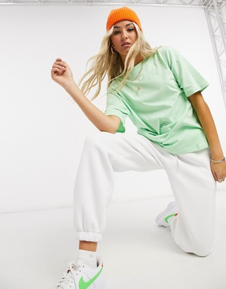 Nike central swoosh oversized boyfriend t-shirt in washed neon green