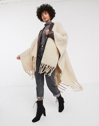Asos Design DESIGN cape in 2 tone fluffy yarns with tassels-Beige