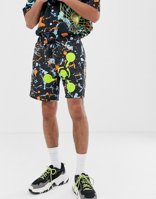 Crooked Tongues Rave all over paint splatter neon swim shorts