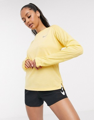 Nike Running pacer long sleeve top in yellow