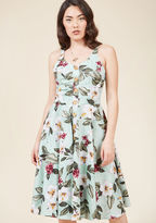 4677 Word will soon get out about the gal in the tropical midi dress from Hell Bunny! Onlookers will take note not only of the sweet sage hue, muted hibiscus pattern, and wooden buttons decorating the front of this pocketed piece, they'll also observe that the