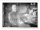 Library Images Newswire Photo (L): A.A. Adee, seated at desk