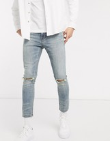 Asos Design DESIGN cropped super skinny jeans in vintage mid wash with busted knee