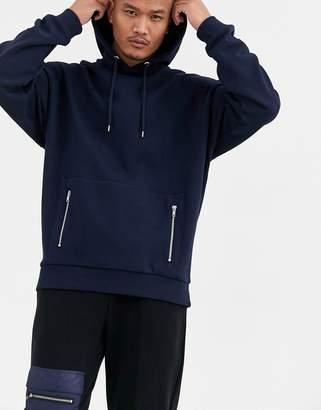 Asos Design DESIGN oversized hoodie in navy with silver zip pockets