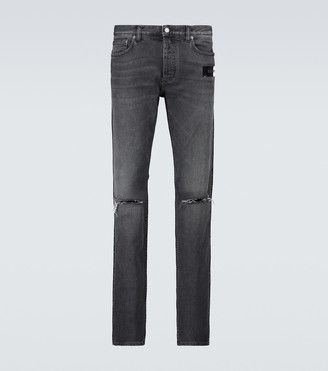 Givenchy Ripped logo skinny jeans