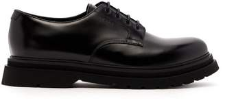 Prada Logo Debossed Leather Derby Shoes - Mens - Black