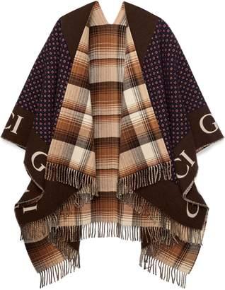 Gucci Reversible wool poncho with geometric motif