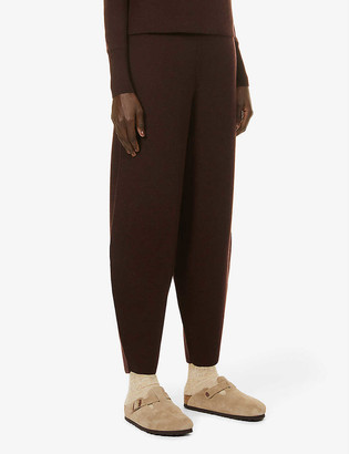 Studio Nicholson Tapered high-rise wool, silk and cashmere-blend trousers