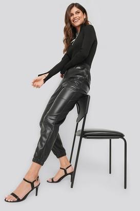 NA-KD Ivana Santacruz X Faux Leather Jogger Pants Black