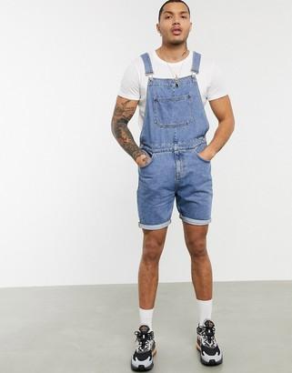 Asos DESIGN denim overall shorts in mid wash