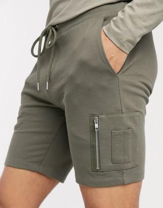 ASOS DESIGN jersey skinny shorts with MA1 pocket in khaki