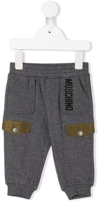 Moschino Kids logo print trousers