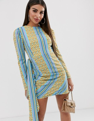 John Zack mini dress with asymmetric ruffle in blue chain print