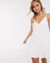 Asos Design DESIGN v front mini sundress with pep hem in white