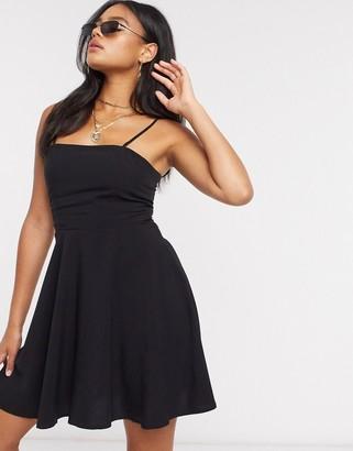 NA-KD flowy mini dress in black