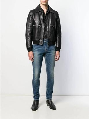 Saint Laurent Faded Mid-rise Slim Jeans