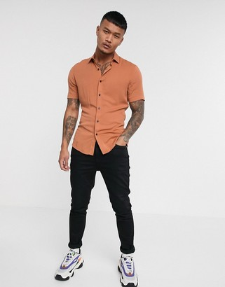 ASOS DESIGN muscle fit viscose shirt in light rust with short sleeves