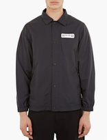 White Mountaineering Black Large Logo Coach Jacket