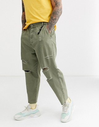 Bershka loose fit jeans with rips in khaki